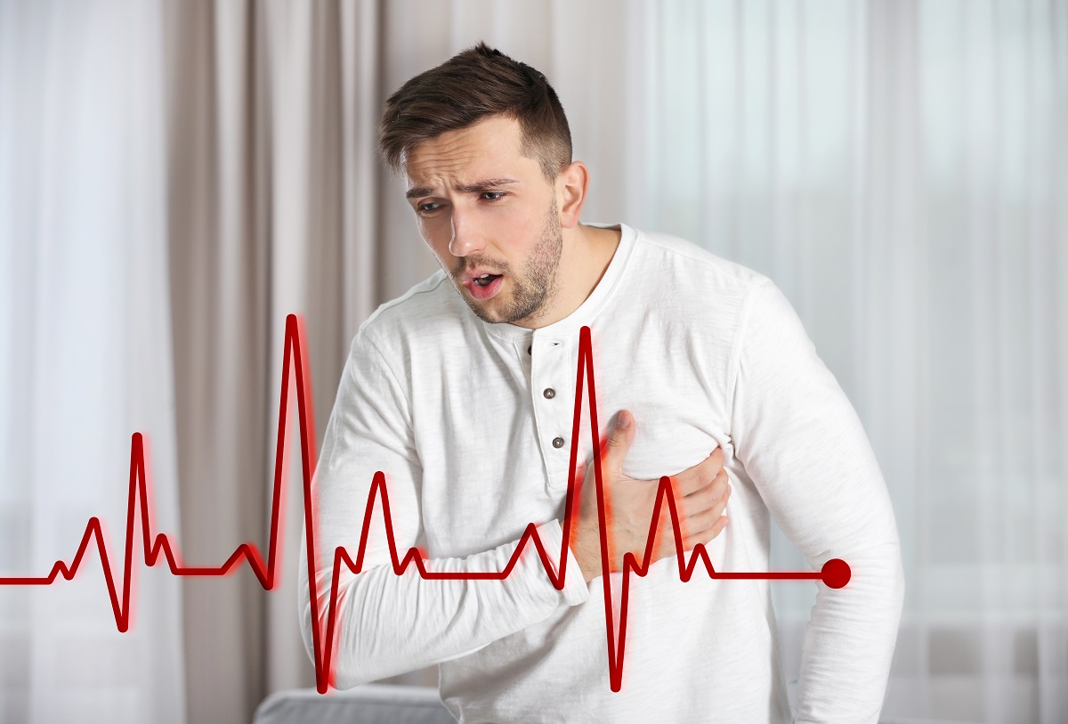 arrhythmia, heart rate, man grabbing by the chest